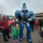 Gavin West meets Rockit the Robot at the fair.