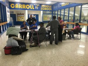 About 20 people had checked into an emergency shelter at Gilbert Carroll Middle School by noon on Saturday.